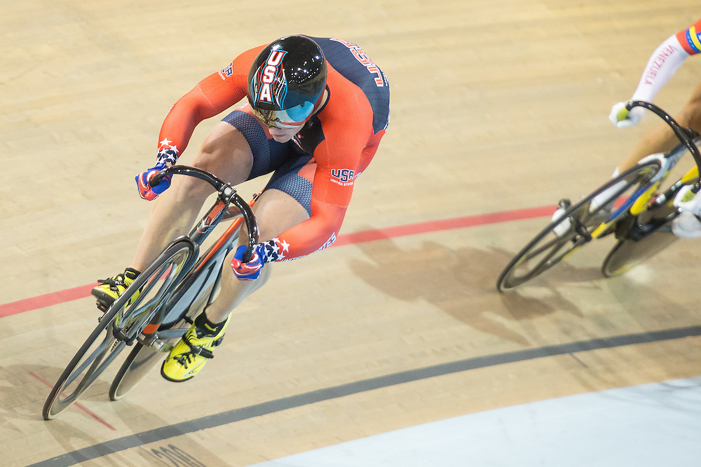Matt Baranoski (L) of the United States leads in his men's cycling sprint quarterfinals at the 2015 Pan American Games in Toronto, Canada, July 17,  2015.  AFP PHOTO/GEOFF ROBINS