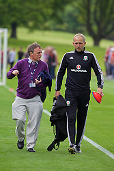 CARDIFF, WALES - Wednesday, June 1, 2016: Wales' coach Paul Trollope and BBC Radio Wales' Rob Phillips during a training session at the Vale Resort Hotel ahead of the International Friendly match against Sweden. (Pic by David Rawcliffe/Propaganda)