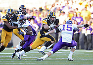 September 15 2012: Iowa Hawkeyes fullback Mark Weisman (45) tries to hold off Northern Iowa Panthers defensive back Garrett Scott (15) during the second half of the NCAA football game between the Northern Iowa Panthers and the Iowa Hawkeyes at Kinnick Stadium in Iowa City, Iowa on Saturday September 15, 2012. Iowa defeated Northern Iowa 27-16.