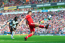 LIVERPOOL, ENGLAND - Sunday, April 11, 2010: Liverpool's captain Steven Gerrard MBE in action against Fulham during the Premiership match at Anfield. (Photo by: David Rawcliffe/Propaganda)