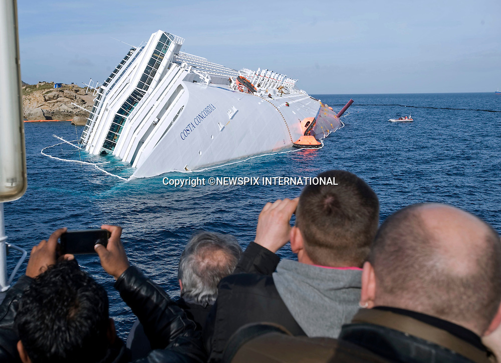 """Isola del Giglio, Italy_24/01/2012: COSTA CONCORDIA DISASTER .The wreck of the Costa Concordia becomes a sight for tourists..The Costa Concordia, which was carrying more than 4,200 people, ran aground a few hundred metres from the tiny Tuscan holiday island of Giglio on the evening of 13/01/2012 as the passengers were at dinner, after apparently sailing off course..Mandatory Credit Photo: ©Giuseppe Pirastru/NEWSPIX INTERNATIONAL..**ALL FEES PAYABLE TO: """"NEWSPIX INTERNATIONAL""""**..IMMEDIATE CONFIRMATION OF USAGE REQUIRED:.Newspix International, 31 Chinnery Hill, Bishop's Stortford, ENGLAND CM23 3PS.Tel:+441279 324672  ; Fax: +441279656877.Mobile:  07775681153.e-mail: info@newspixinternational.co.uk"""