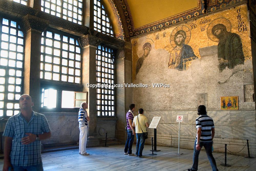 Hagia Sophia. Deesis mosaic. Byzantine mosaic and tourists. Istanbul. Turkey