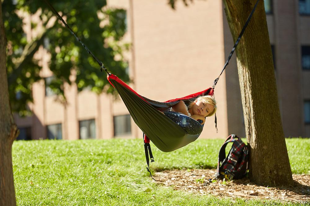 Fall; September; Location; Outside; People; Woman Women; Student Students; Time/Weather; day; sunny; Type of Photography; Candid; UWL UW-L UW-La Crosse University of Wisconsin-La Crosse; Student Sleeping in a Hamock