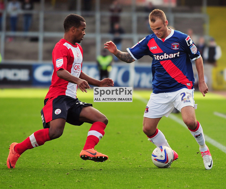 Nathan Byrne (Crawley Town, red) and Kallum Higginbotham. .Carlisle v Crawley, Npower League One, 29th September 2012..(c)  Alex Todd | StockPix.eu