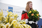 Flower ceremony girl in the winners enclosure of White Turf 2011 horse racing event in St Moritz, Switzerland.