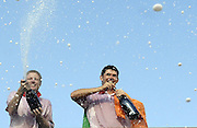 European team members Luke Donald (L) and Padraig Harrington spray champaign as they celebrate their team's win in the 2006 Ryder Cup golf tournament, in Straffan, Ireland.