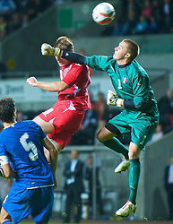SWANSEA, ENGLAND - Friday, September 4, 2009: Wales' Sam Vokes and Italy's goalkeeper Vincenzo Fiorllo during the UEFA Under 21 Championship Qualifying Group 3 match at the Liberty Stadium. (Photo by David Rawcliffe/Propaganda)