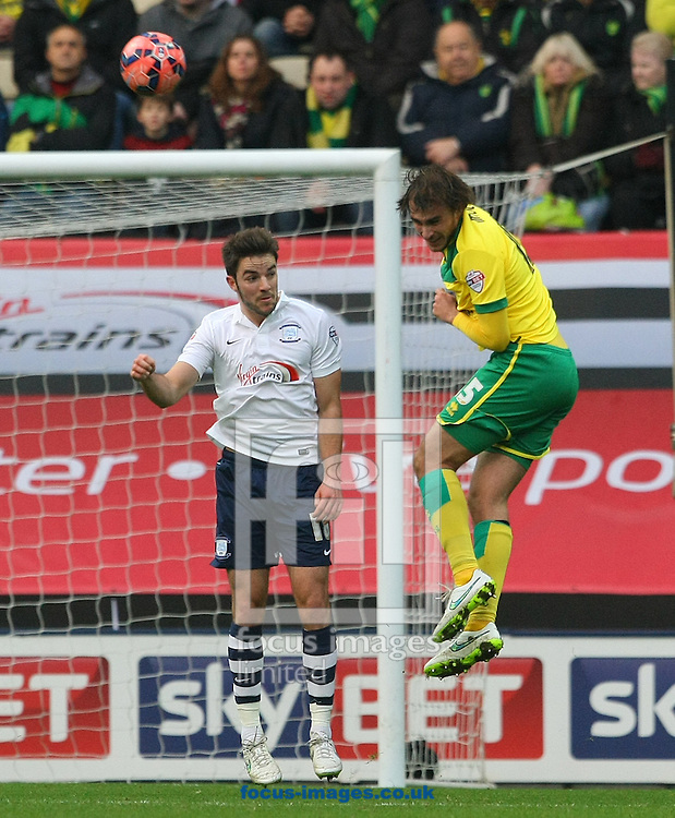Ignasi Miquel of Norwich wins a header during the FA Cup match at Deepdale, Preston<br /> Picture by Paul Chesterton/Focus Images Ltd +44 7904 640267<br /> 03/01/2015