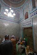 Uzbekistan, Khiva. Pilgrims at Makhmud Pakhlavan Mausoleum.