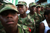 Soldiers keep watch during at a religious parade in Quibdo, the capital of the state of Choco, on October 4, 2006. Choco is a state that has suffered terribly at the hands of both rightwing paramilitaries and leftist rebels over the years, causing many to flee to other parts of Colombia. The Choco is located on the Pacific coast of Colombia and most of the people are black descendants of African slaves. (Photo/Scott Dalton)