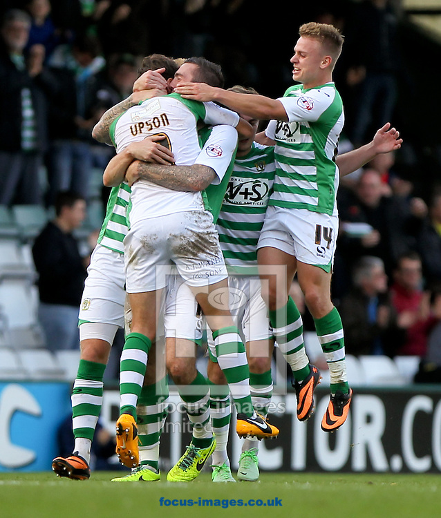 Picture by Tom Smith/Focus Images Ltd 07545141164<br /> 26/10/2013<br /> Edward Upson (centre left) of Yeovil Town is mobbed by his team mates after scoring his second goal of the match during the Sky Bet Championship match at Huish Park, Yeovil.