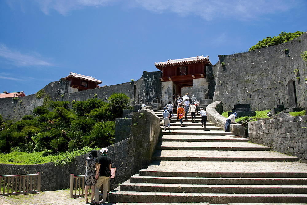 "Visitors walk down the steps from Zuisenmon gate inside the grounds of Shuri-jo Castle  in Naha, Okinawa Prefecture, Japan, on May 28, 2012. Zuisenmon, which means ""splendid and auspicious spring,"" takes its name from the Ryuhi"" spring just in front of it."