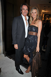 TIM & MALIN JEFFERIES at a reception hosted by Vogue and Burberry to celebrate the launch of Fashions Night Out - held at Burberry, 21-23 Bond Street, London on 10th September 2009.