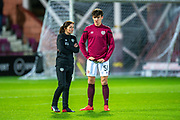 Heart of Midlothian medic, Karen Gibson speaks with Aaron Hickey (#51) of Heart of Midlothian FC before the Ladbrokes Scottish Premiership match between Heart of Midlothian FC and Livingston FC at Tynecastle Park, Edinburgh, Scotland on 4 December 2019.