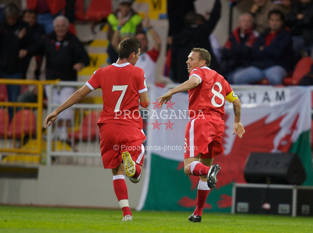 Trnava, Slovakia - Wednesday, September 12, 2007: Wales' Craig Bellamy celebrates scoring the second goal against Slovakia with Joe Ledley during the UEFA Euro 2008 Qualifying Group D match at the Anton Malatinsky Stadium. (Photo by David Rawcliffe/Propaganda)