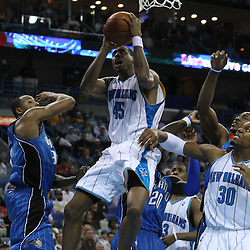 18 February 2009: New Orleans Hornets guard Rasual Butler (45) shoots over Orlando Magic defenders Rashard Lewis (9) and Mickael Pietrus (20) during a NBA basketball game between the Orlando Magic and the New Orleans Hornets at the New Orleans Arena in New Orleans, Louisiana.