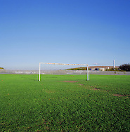 A set of football goalposts on a pitch at New Ferry next to the river Mersey in Wirral. The Mersey is a river in north west England which stretches for 70 miles (112 km) from Stockport, Greater Manchester, ending at Liverpool Bay, Merseyside. For centuries, it formed part of the ancient county divide between Lancashire and Cheshire.