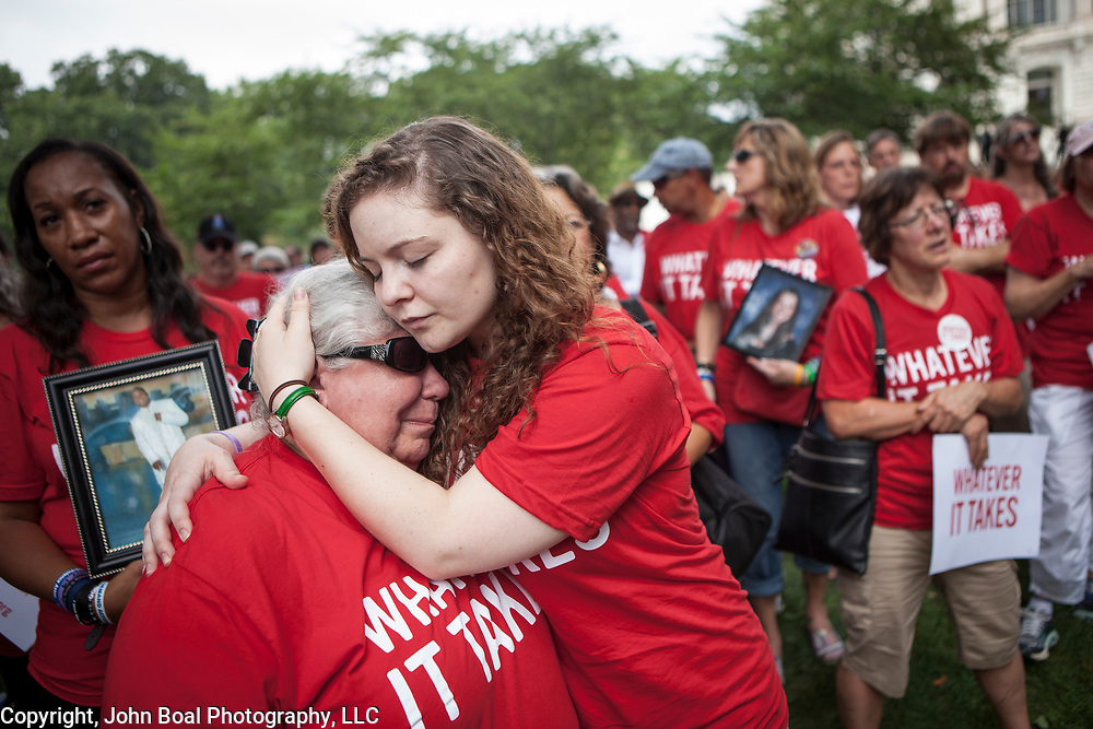 Ashley Cech, of Everytown for Gun Safety, consoles Diane Hellgren, 60, who lost her daughter, Angela Frankenberry, 31, to suicide on July 6, 2011.  Frankenberry had a history of depression and purchased a gun to commit suicide on the 26th anniversary of her father's suicide.  Andy Parker, made his first visit to Washington, D.C. since his daughter, WDBJ_TV reporter was shot and killed on live television near Roanoke, VA last week.  The rally, organized by Everytown for Gun Safety, brought Parker together with Virginia Senators, Mark Warner, Tim Kaine and Virginia Governor, Terry McAuliffe near the United States Capitol, on Thursday, September 10, 2015.  John Boal/for The New York Daily News