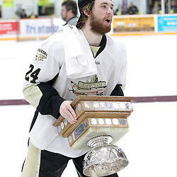 TRENTON, ON - Apr 22, 2016 -  Ontario Junior Hockey League game action between Trenton Golden Hawks and the Georgetown Raiders. Game 5 of the Buckland Cup Championship Series  at the Duncan Memorial Gardens in Trenton, Ontario. Jordan DaSilva #24 of the Trenton Golden Hawks hoists the Buckland Cup.<br /> (Photo by Tim Bates / OJHL Images)