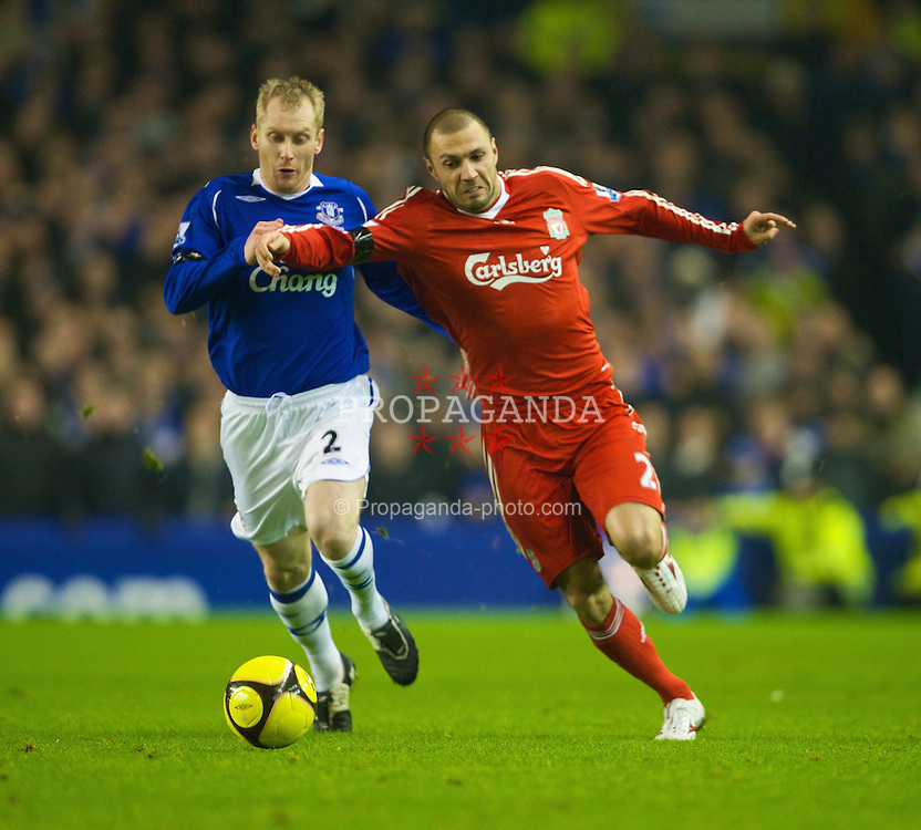LIVERPOOL, ENGLAND - Wednesday, February 4, 2009: Liverpool's Andrea Dossena and Everton's Tony Hibbert during the FA Cup 4th Round Replay match at Goodison Park. (Mandatory credit: David Rawcliffe/Propaganda)