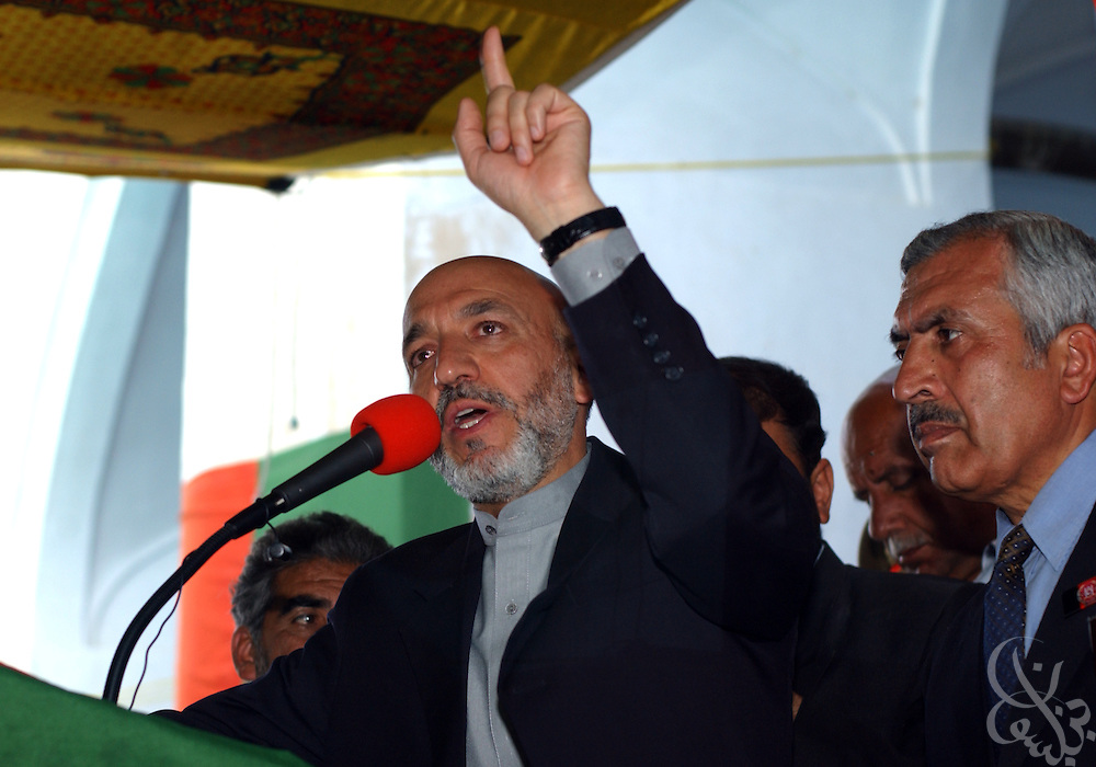 Interim Afghan leader Hamid Karzai addresses a group of tribal elders May 04, 2002 in the southern Afghan city of Kandahar. The visit by Karzai to the city, his first since assuming power, is significant because of the city's history as a former Taliban stronghold.