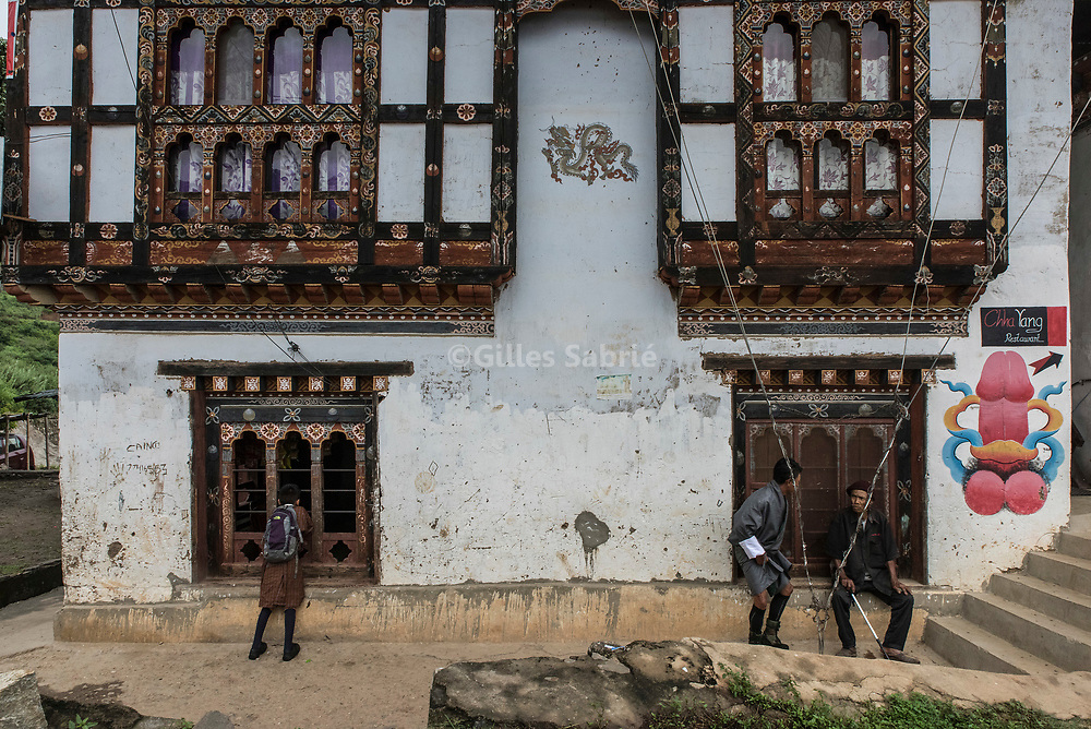 For a story by Steven Lee Myers, Bhutan<br /> Lobesa, Bhutan, August 2nd, 2017<br /> A house in Lobesa village adorned with a mural painting of a phallus. Locals believe that the phallic symbols bring good luck and drives away evil spirits, Its origin can be found in the Bon religion that predated the advent of Tibetan Buddhism. Phallus representations are also linked to the XVIth century Lama Drukpa Kunley  popularly known as the &ldquo;Divine Madman&rdquo; for his unorthodox ways of teaching, and for his bizarre and shocking behaviours.<br /> Gilles Sabri&eacute; pour The New York Times