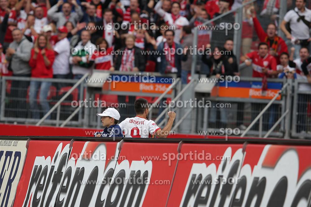 29.09.2012, easyCredit Stadion, Nuernberg, GER, 1. FBL, 1. FC Nuernberg vs VfB Stuttgart, 06. Runde, im Bild Vedad IBISEVIC (VfB Stuttgart) springt ueber die Bande und jubelt zu den VfB Fans // during the German Bundesliga 06th round match between 1. FC Nuernberg and VfB Stuttgart at the easyCredit Stadium, Nuernberg, Germany on 2012/09/29. EXPA Pictures © 2012, PhotoCredit: EXPA/ Eibner/ Eckhard Eibner..***** ATTENTION - OUT OF GER *****