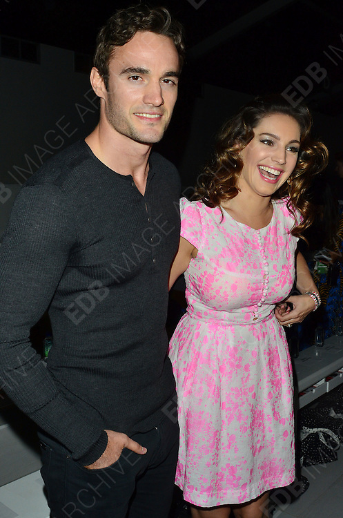 15.SEPTEMBER.2012. LONDON<br /> <br /> KELLY BROOK AND THOM EVANS ATTEND THE ISSA LFW CATWALK SHOW.<br /> <br /> BYLINE: EDBIMAGEARCHIVE.CO.UK/JOE ALVAREZ<br /> <br /> *THIS IMAGE IS STRICTLY FOR UK NEWSPAPERS AND MAGAZINES ONLY*<br /> *FOR WORLD WIDE SALES AND WEB USE PLEASE CONTACT EDBIMAGEARCHIVE - 0208 954 5968*