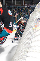 KELOWNA, CANADA, NOVEMBER 25: Madison Bowey #4 of the Kelowna Rockets skates behind the net as the Kootenay Ice visit the Kelowna Rockets  on November 25, 2011 at Prospera Place in Kelowna, British Columbia, Canada (Photo by Marissa Baecker/Shoot the Breeze) *** Local Caption *** Madison Bowey;