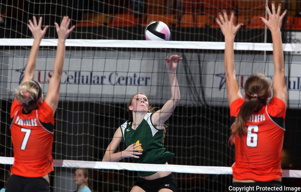 LeMars Gehlen Catholic's Katelin Langel (4) tries to get the ball between Tripoli's Natalie Figanbaum (7) and Megan Gilbert (6) during their 1A semifinal match in the state volleyball tournament at the U.S. Cellular Center at 370 1st Ave E on Friday evening, November 12, 2010. (Stephen Mally/Freelance)