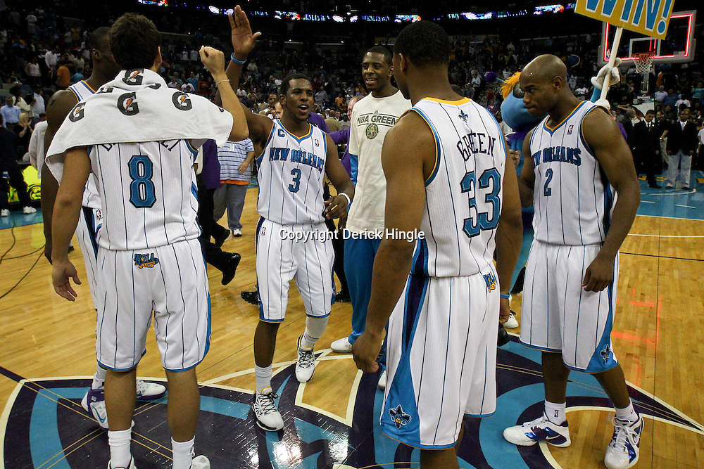 April 6, 2011; New Orleans, LA, USA; New Orleans Hornets point guard Chris Paul (3) celebrates with teammates following a win over the Houston Rockets at the New Orleans Arena. The Hornets defeated the Rockets 101-93 and clinched a playoff spot with the victory.   Mandatory Credit: Derick E. Hingle-US PRESSWIRE