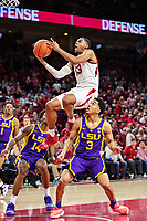 FAYETTEVILLE, AR - JANUARY 12:  Mason Jones #13 of the Arkansas Razorbacks goes up for lay up over Tremont Waters #3 of the LSU Tigers at Bud Walton Arena on January 12, 2019 in Fayetteville, Arkansas.  The Tigers defeated the Razorbacks 94-88.  (Photo by Wesley Hitt/Getty Images) *** Local Caption *** Mason Jones; Tremont Waters