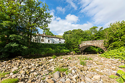 © Licensed to London News Pictures. 12/06/2018. Hubberholme UK. A stretch of the River Wharf has dried up in Hubberholme in the Yorkshire Dales due to the recent lack of rain causing fears of a possible drought. Britain could be heading for a three month heatwave with temperatures hitting 29c by July. Photo credit: Andrew McCaren/LNP