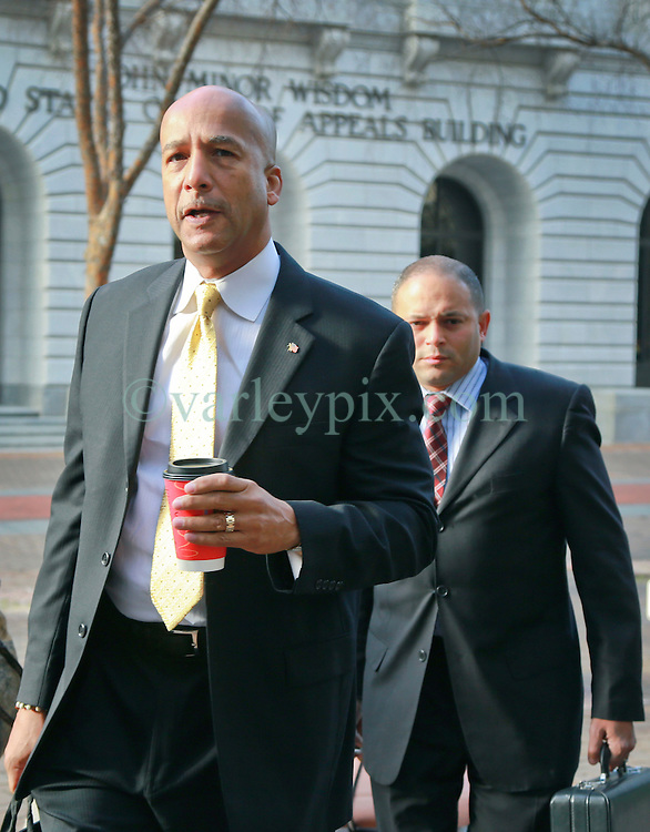 31 January 2014. New Orleans, Louisiana. <br /> Ray Nagin, former mayor of New Orleans walks to Federal court surrounded by his lawyers on the first full day of his corruption trial at the Federal Courthouse. Nagin is charged with 21counts of corruption including  bribery, conspiracy, money laundering and wire fraud. <br /> Photo; Charlie Varley