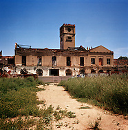 "Poble Nou, Barcelona..Can Ricart is one of the oldest textile factories of Poble Nou. The factory was built in 1850. In 1950 it closed and the building was split in 75 different working places where several companies were housed . A factory block  was also rent to a group of artists who opened inside their study, named Hangar. In 2000 Barcelona CIty Council approved a new urban program, called  ""22@"" and started to convert the entire area from industrial to building land. For this reason Can Ricart's owner sold the factory evicting all companies who worked inside. All business closed from 2005 to 2007, except Hangar  that still resist."