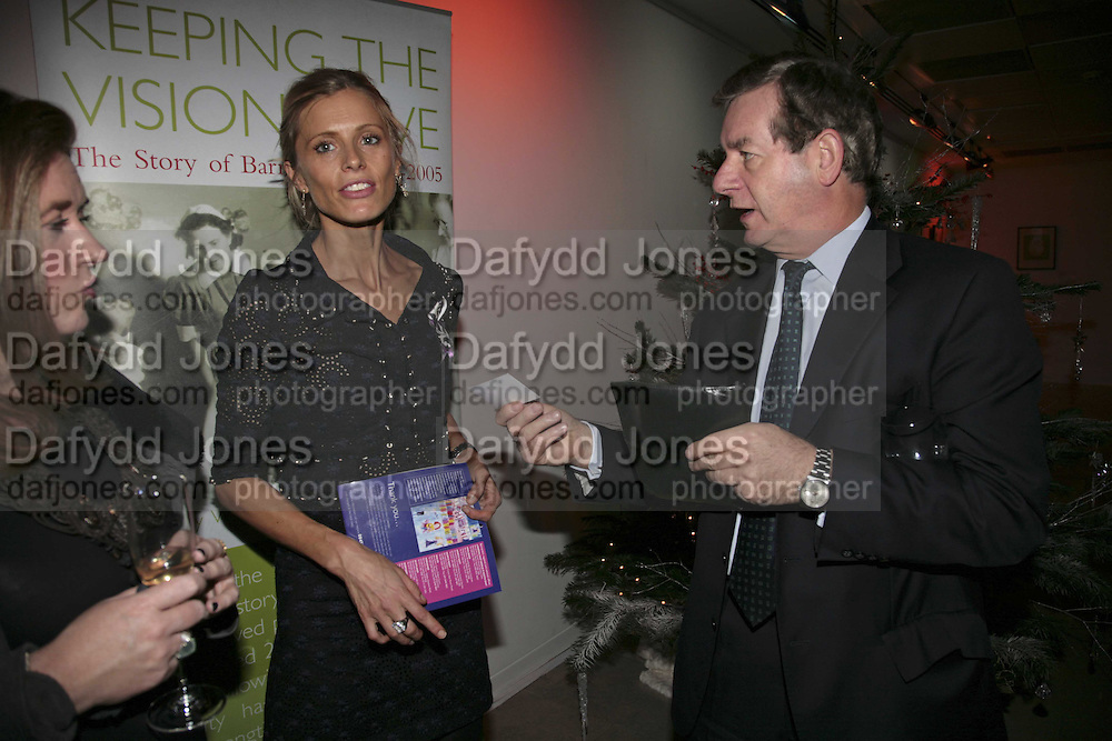 LAURA BAILEY AND  NICK LLOYD, Barnardoês Christmas champagne reception at The Hospital, Endell Street, WC2 . 12 December 2006. ONE TIME USE ONLY - DO NOT ARCHIVE  © Copyright Photograph by Dafydd Jones 248 CLAPHAM PARK RD. LONDON SW90PZ.  Tel 020 7733 0108 www.dafjones.com