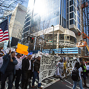 Charlotte, NC - Residents march in solidarity with the undocumented population of the US and Charlotte on A Day Without Immigrants. The marchers are passing by 300 Tryon, one of the newest towers being built in uptown Charlotte.
