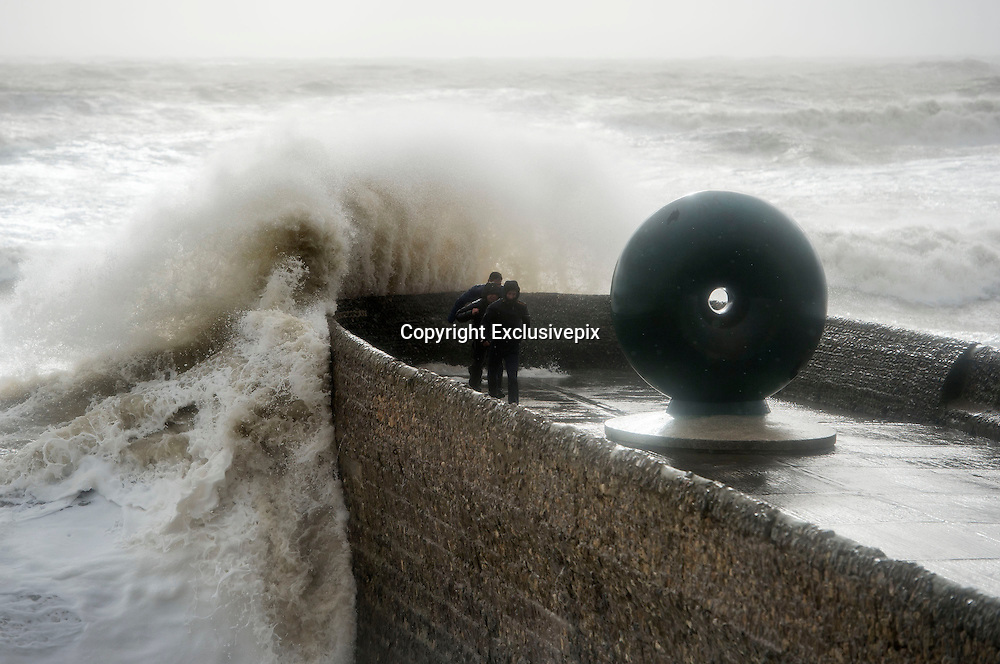 Winds and storms hit Britain<br /> Gale force winds, rain and tidal surges continue to batter the UK coastlines today. Scenes from Brighton, Sussex, UK. Young men take huge risks by trying to get pictures of large waves<br /> &copy;Exclusivepix