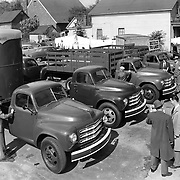 Studebaker 2R-Series trucks at a new-truck showing.