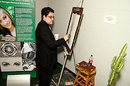 WSU junior Mark Cela works on art that's part of the silent auction during the 14th Annual ArtsGala at Wright State University's Creative Arts Center, Saturday, April 6, 2013.  Cela is the first student to receive a Sophie Kerrigan Memorial Scholorship award, named for a Bellbrook High School student killed in an automobile accident in 2012.