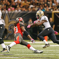 Oct 5, 2014; New Orleans, LA, USA; New Orleans Saints running back Khiry Robinson (29) runs past Tampa Bay Buccaneers strong safety Mark Barron (23) during the first quarter of a game at Mercedes-Benz Superdome. Mandatory Credit: Derick E. Hingle-USA TODAY Sports