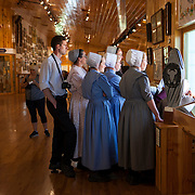 A group of Mennonite women visit the Crazy Horse Memorial, a monument under construction on Thunderhead Mountain, a privately held land in the Black Hills, Custer County, South Dakota. It depicts Crazy Horse, an Oglala Lakota warrior, riding a horse and pointing into the distance. The memorial was commissioned by Henry Standing Bear, a Lakota elder, to be sculpted by Korczak Ziolkowski.  Photography by Jose More