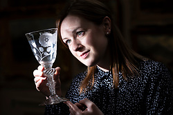 The Bonham's Scottish Sale takes place at Bonham's in Edinburgh on Wednesday 25 April at 1pm. Now in its 19th year it features works by leading Scottish artists as well as a huge range of objects related to Scotland.<br /> <br /> Pictured: A Jacobite Airtwist Goblet from c.1750 examined by Georgia Williams of Bonhams. Valued between &pound;3,000 and &pound;5,000