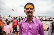 Hindu man portrayed at Dashashwamedh Gath by the Ganges River in Varanasi, India.