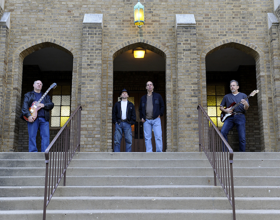 CHICAGO-NOVEMBER 05: Members of the band The Stingers pose for a publicity photo in Chicago, Illinois on November 5, 2011.  Members include (L to R) Dan Kening (guitar), Mark Malen (drums and vocals), Henry Small (keyboard, harp and vocals) and Ron Vesely (bass).
