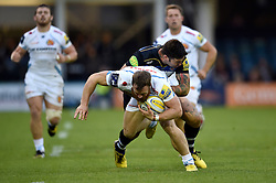 James Short of Exeter Chiefs is tackled by Matt Banahan of Bath Rugby - Mandatory byline: Patrick Khachfe/JMP - 07966 386802 - 10/10/2015 - RUGBY UNION - The Recreation Ground - Bath, England - Bath Rugby v Exeter Chiefs - West Country Challenge Cup.