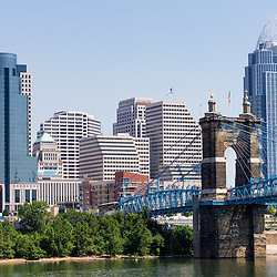 Photo of Cincinnati Ohio skyline, John A. Roebling bridge, and downtown city office buildings including Great American Insurance Group Tower, Omnicare building, and Scripps Center building. Photo was taken in July 2012.