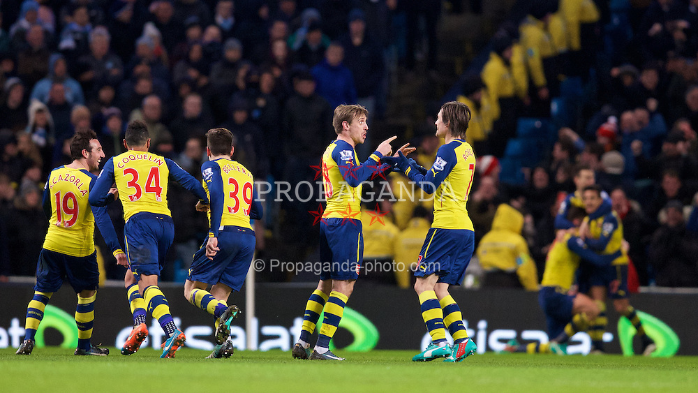 MANCHESTER, ENGLAND - Sunday, January 18, 2015: Arsenal's Nacho Monreal and Tomas Rosicky celebrate their side's second goal against Manchester City during the Premier League match at the City of Manchester Stadium. (Pic by David Rawcliffe/Propaganda)