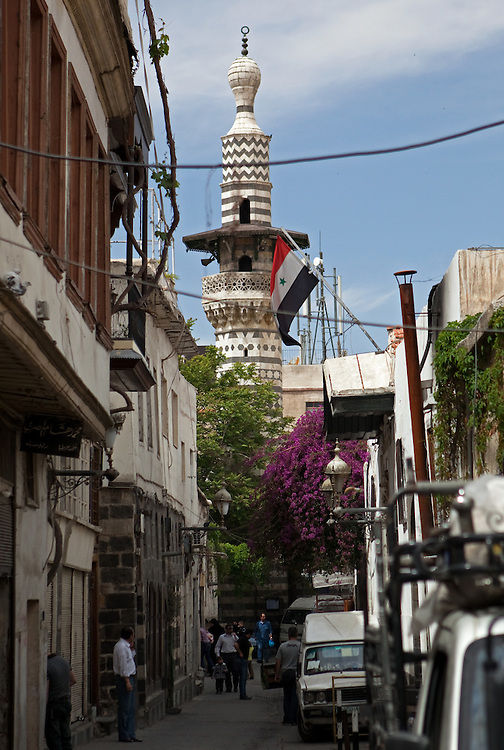 Mosque minaret and Syrian flag on a side street, Old City, Damascus