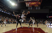 Dec 19, 2017; Los Angeles, CA, USA; Southern California Trojans guard Jordan McLaughlin (11) shoots the ball as Princeton Tigers guard Devin Cannady (3), forward Sebastian Much (33) and guard Amir Bell (5) defend during an NCAA basketball game at Galen Center. Princeton defeated USC 103-93 in overtime.